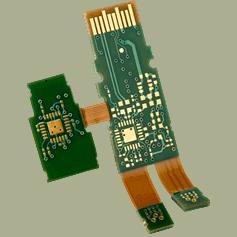 A photo of a green rigid-flex printed circuit board